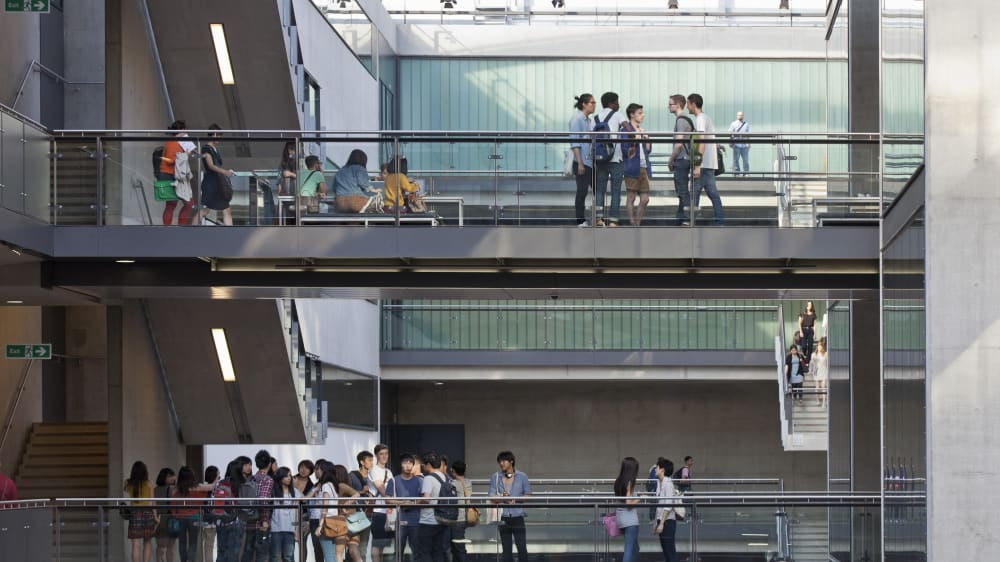 Students milling about on three levels