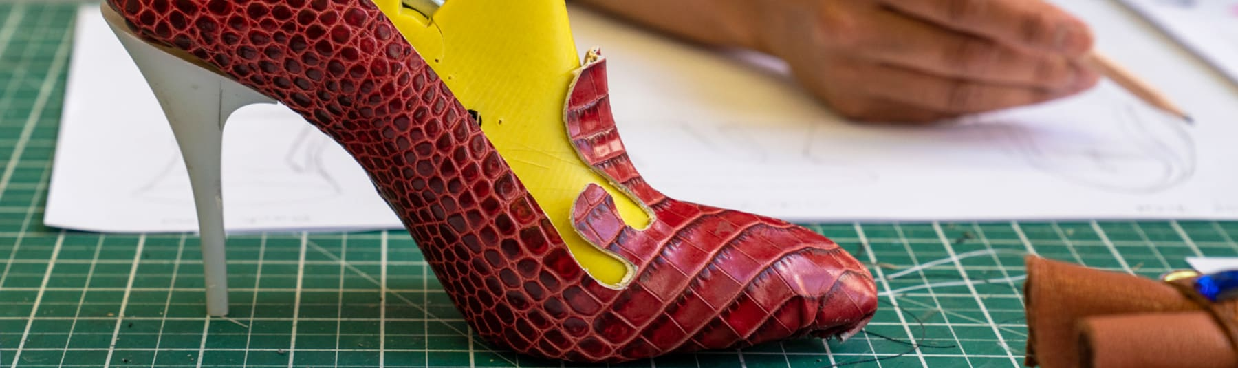 Student sketching heeled shoe