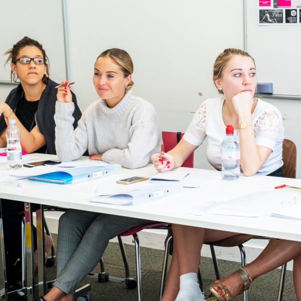 Fashion production students in classroom