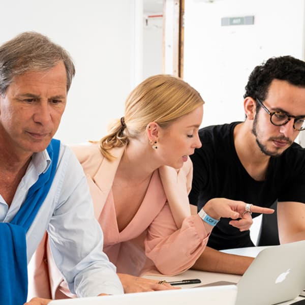 Luxury brand management and product design tutor with students