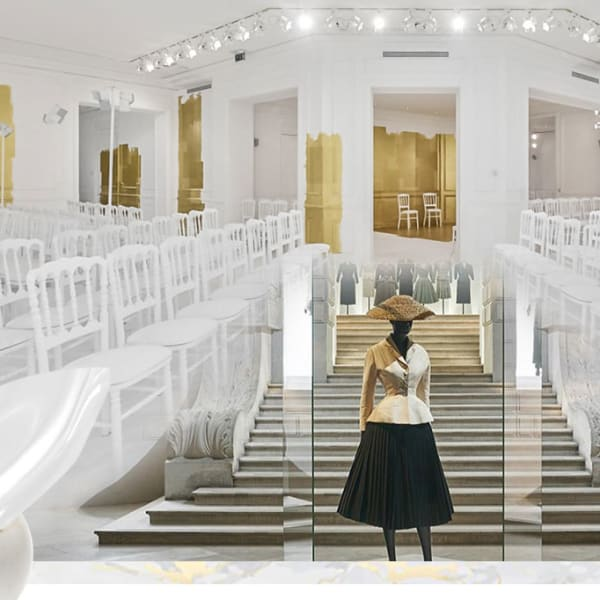 Graphic design image; luxury fashion outfit on mannequin at the foot of wide staircase, flanked by rows of empty chairs set up like a fashion runway.