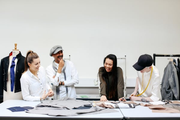 Students looking at work on a table