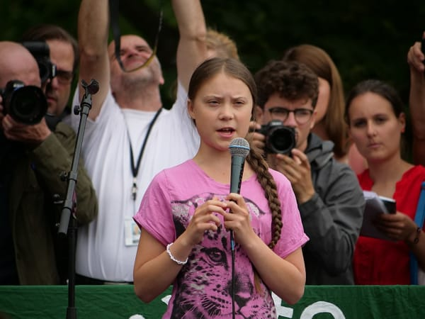 Young activist speaking in front of crowd