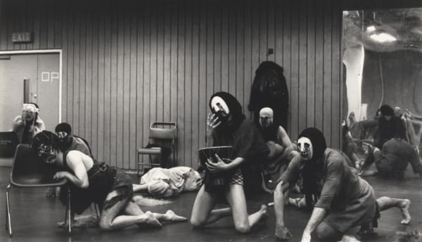 Actors with masks on rehearsing the play Furies