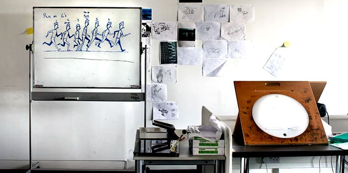 An animation workstation featuring lightbox and sketches.