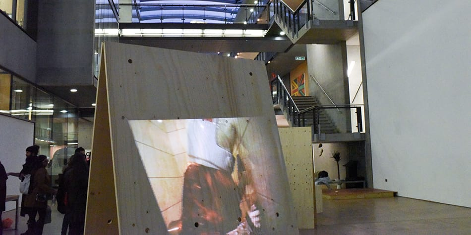 Large wooden board with image projected on to it