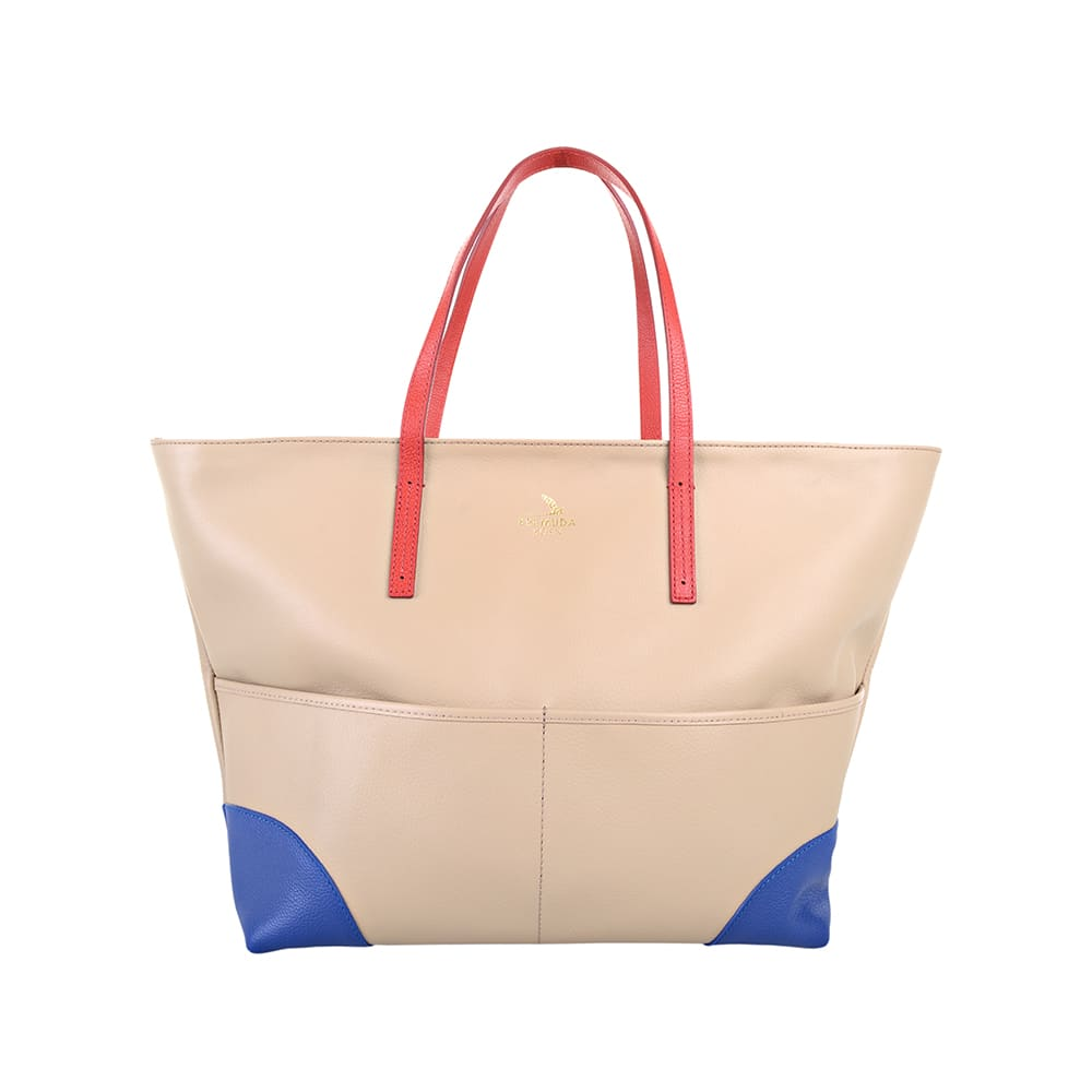 A beige tote bag with blue corner caps and red handle