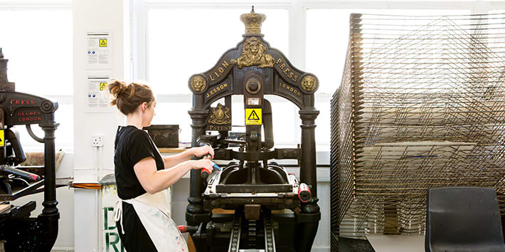 A technician operating one of LCC's traditional presses.