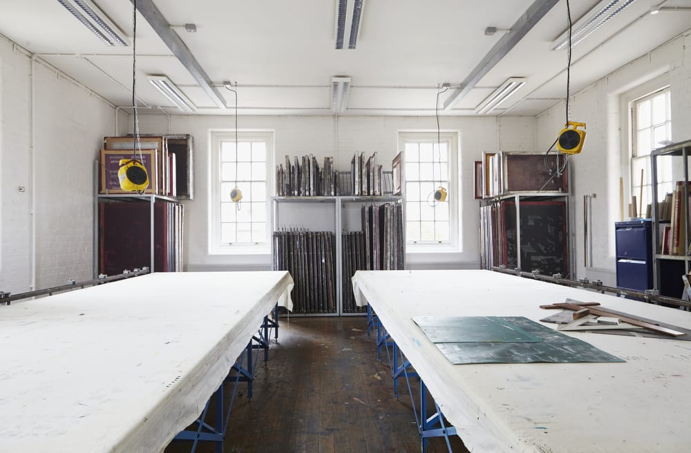Screenprinting tables in the Chelsea textiles workshops.