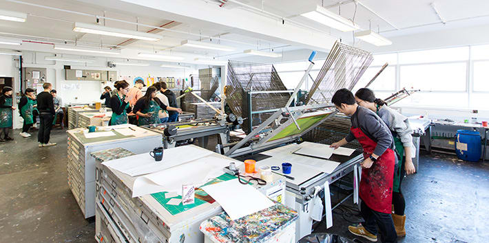 A large group of students at work in the Printmaking area.