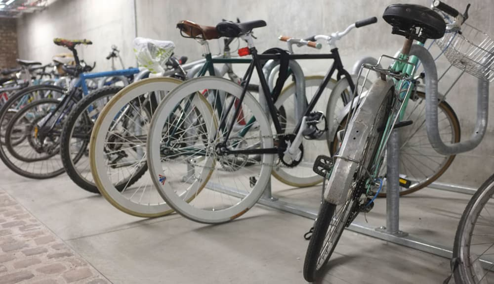 A row of bikes parked in a basement