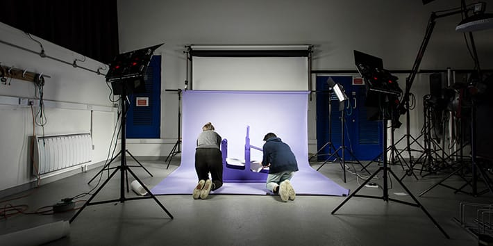 Two students working in a Design Block Photography Studio.