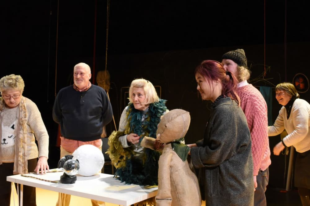 Elderly people and students in a theatre workshop