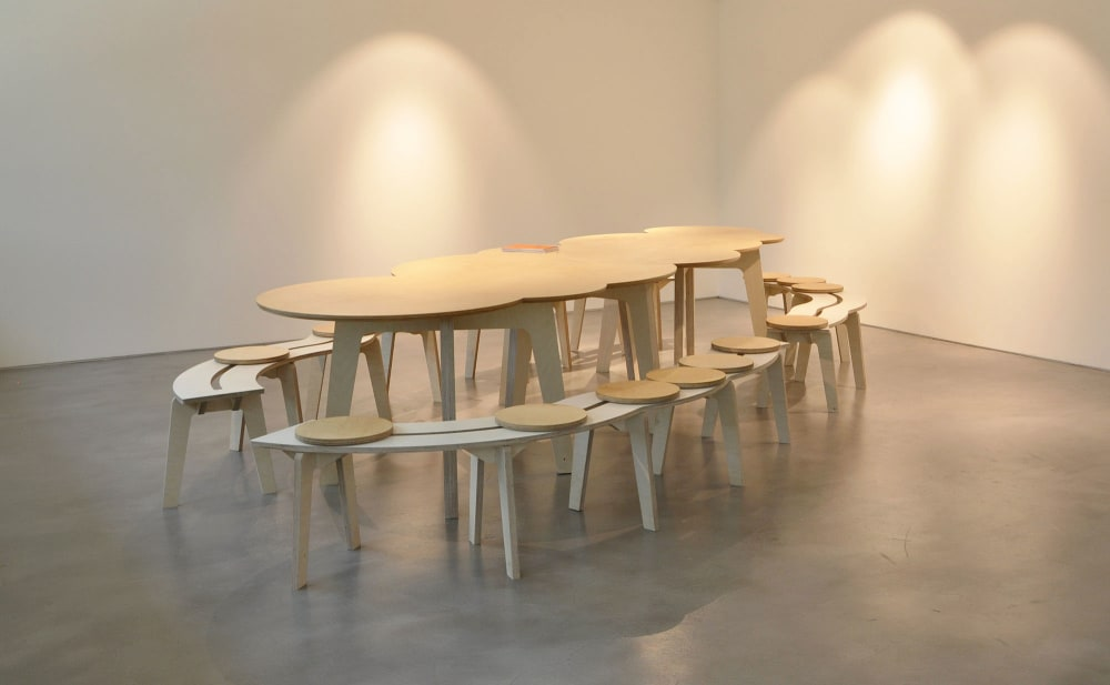 Table and chairs in the On the Way to Language exhibition