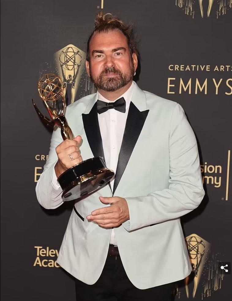 Marc Pilcher holding award