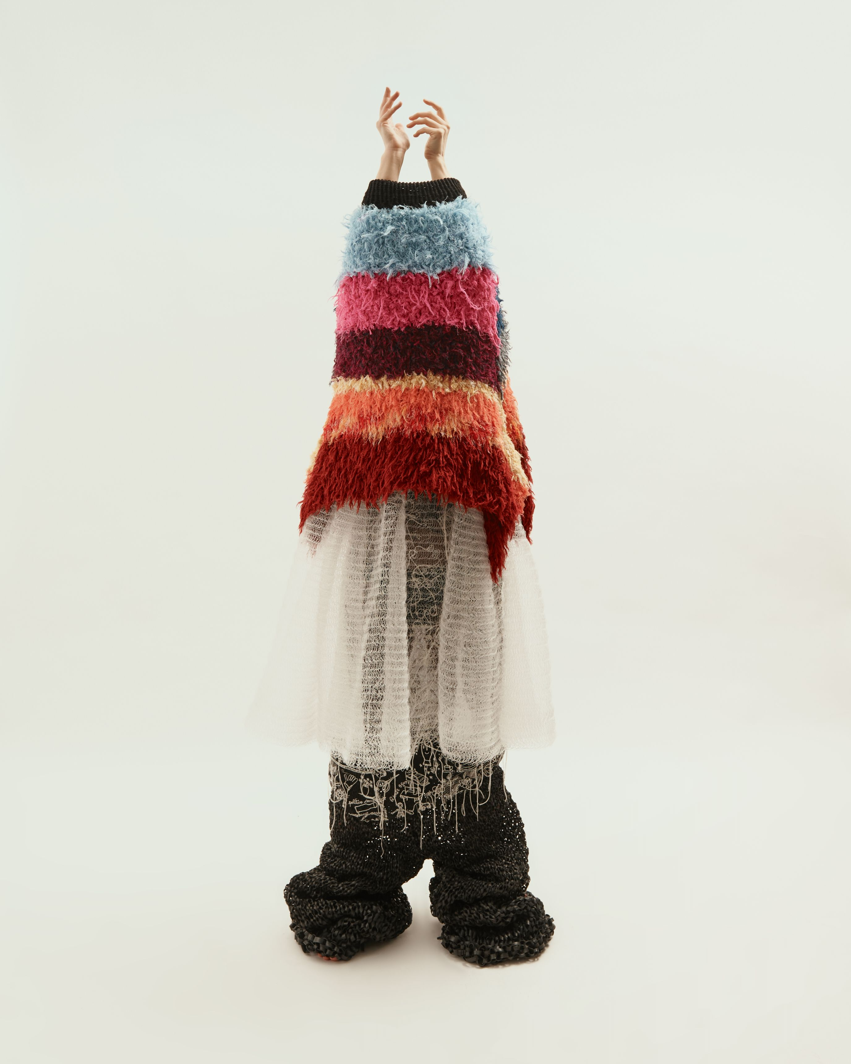 Person standing with knitted clothing on