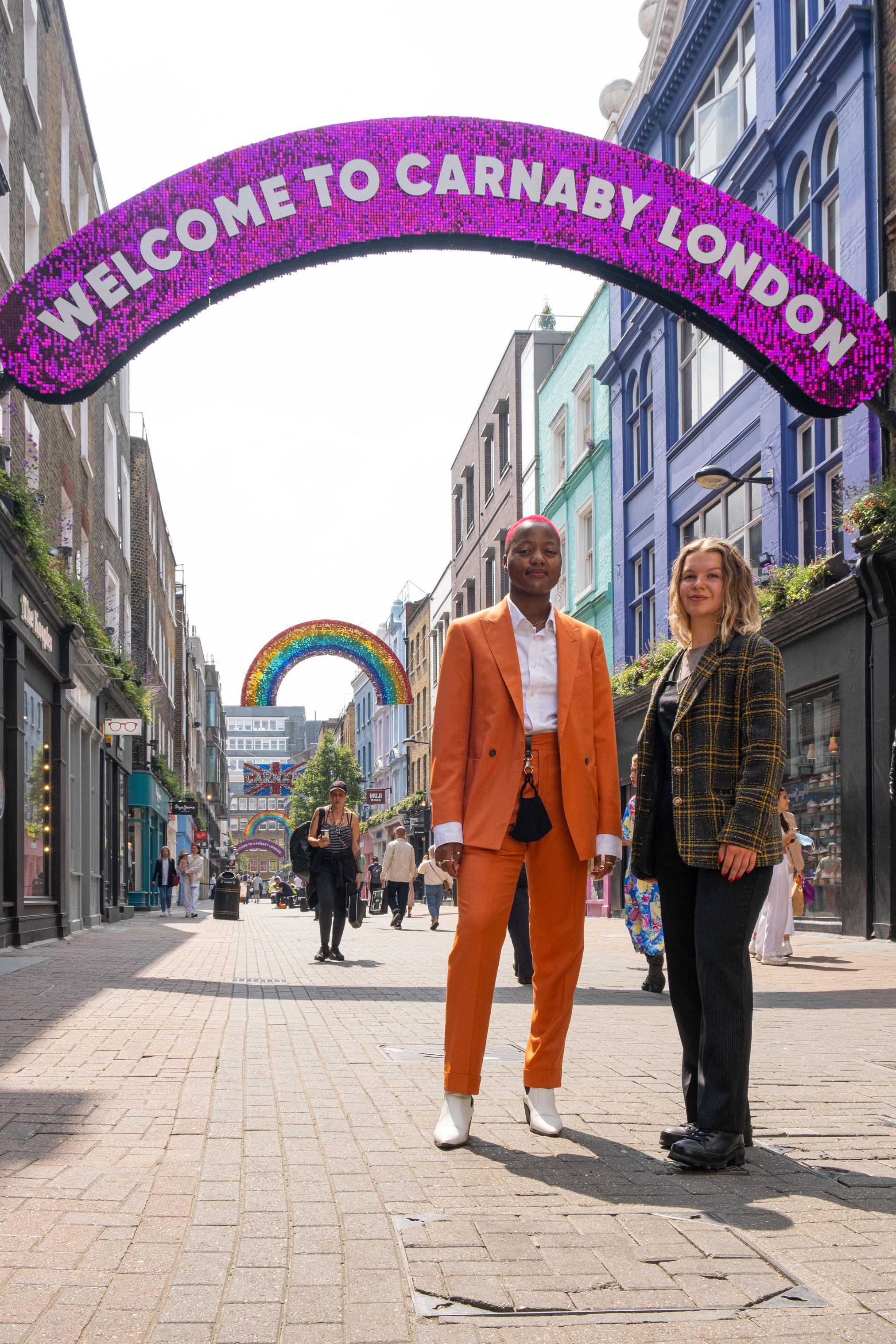Photo of Takudzwa Chigaduro and Leisha Parlour standing in Carnaby Street