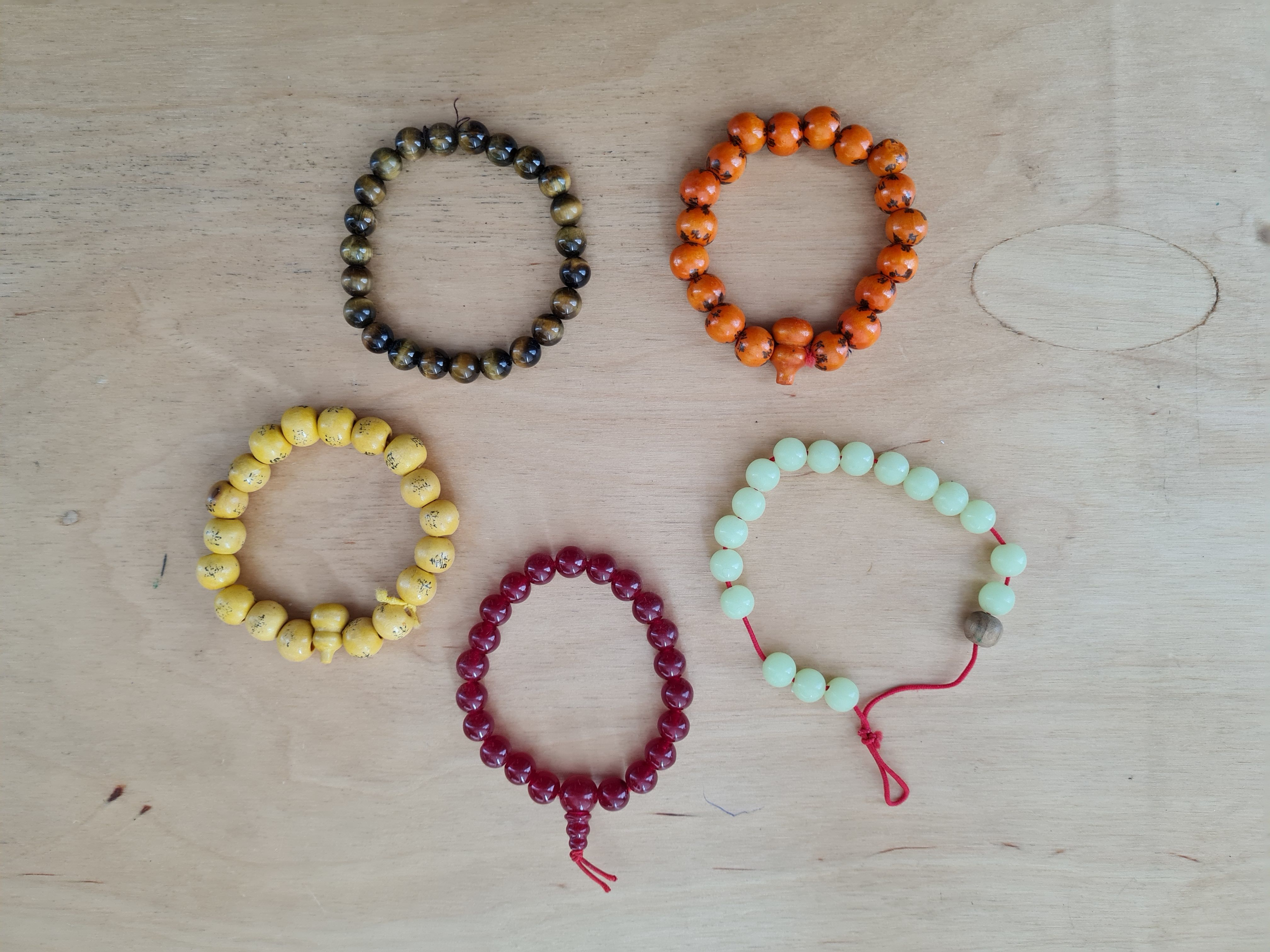 various beaded bracelets laid out on a table