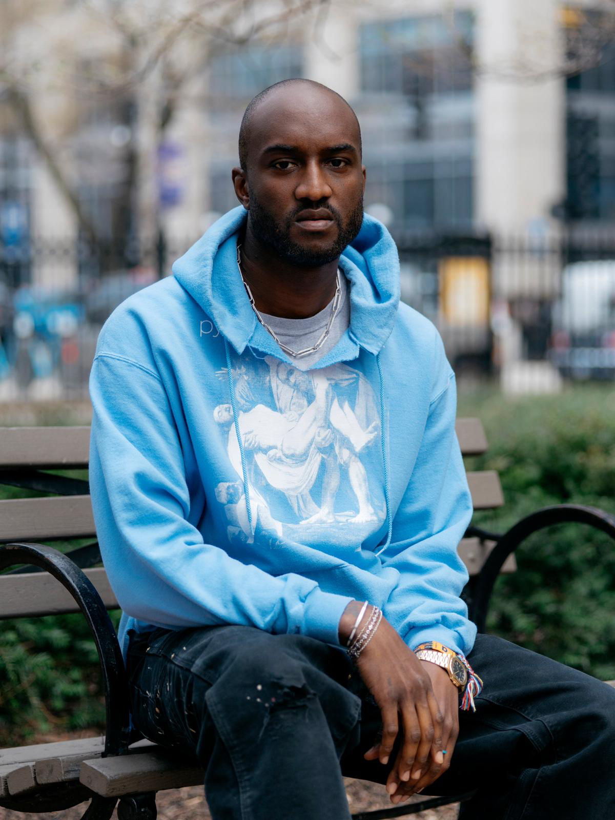 Virgil abloh sitting with a blue hoodie