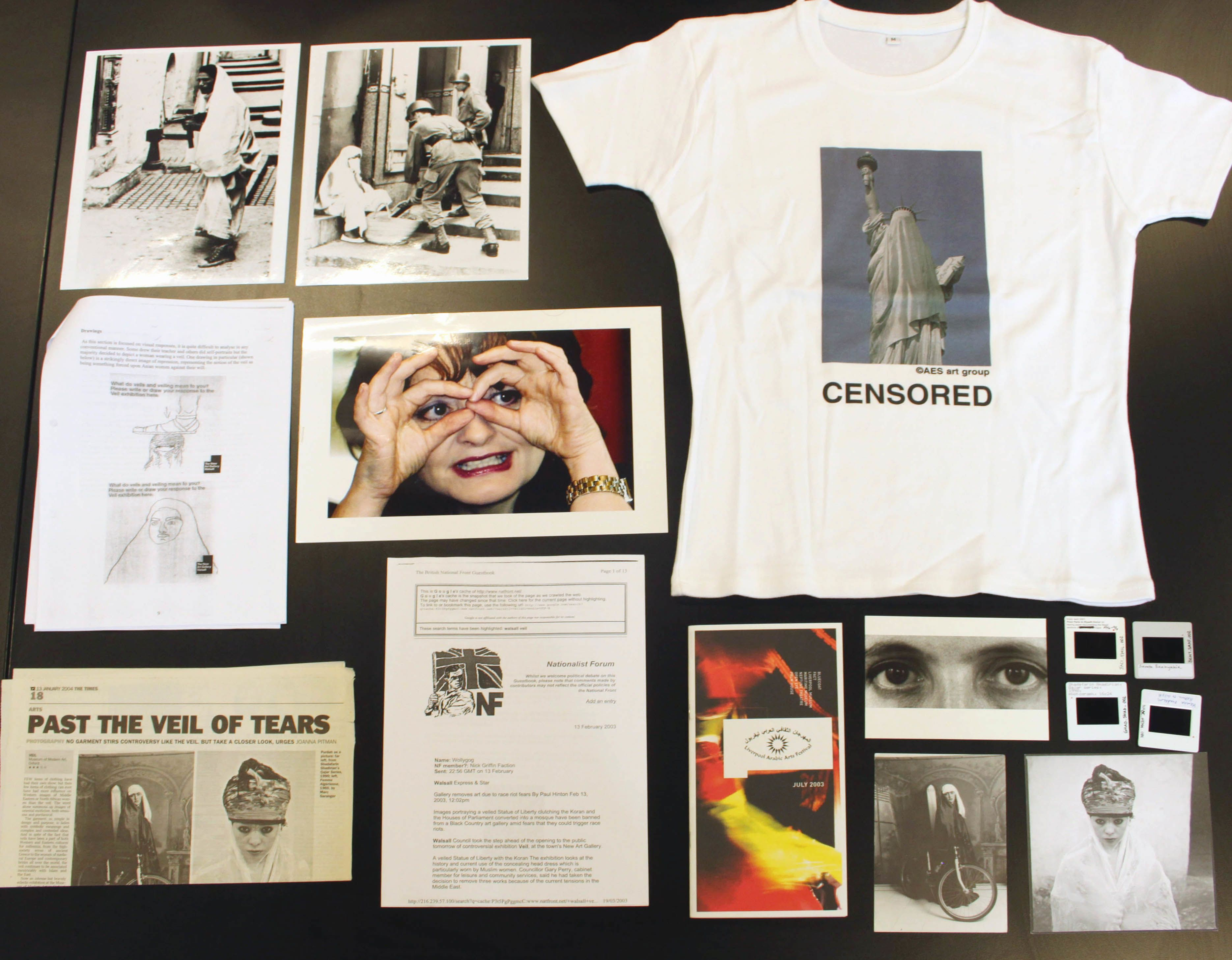 Close up of different archive materials including photos, newspaper articles and a white t-shirt with the slogan 'Censored'