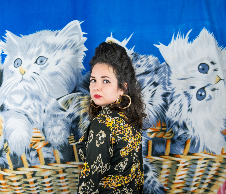 woman standing in front of a kitten blanket