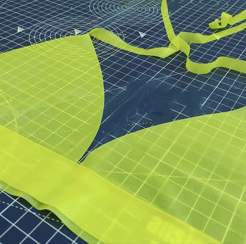 A fabric cut out of a neon green bra