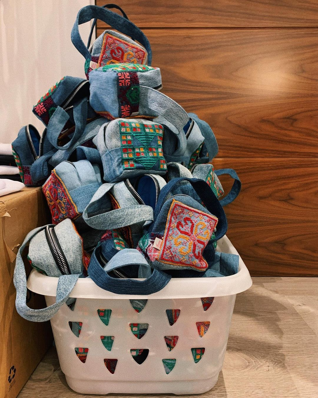 Denim bags stacked in a basket