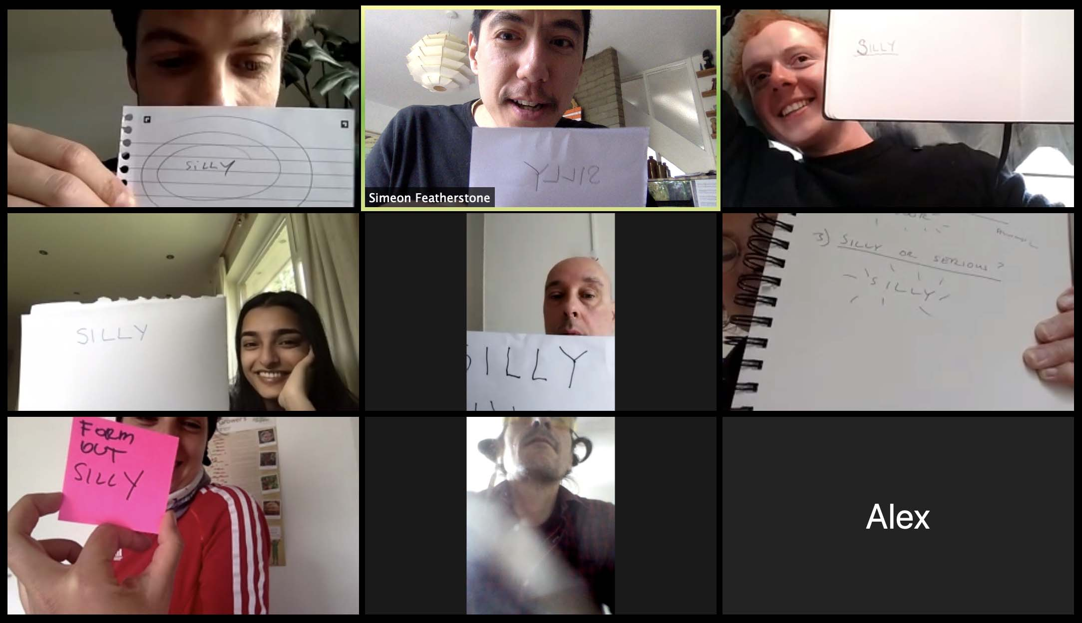 Screenshoot of nine people on Zoom platform holding up signs