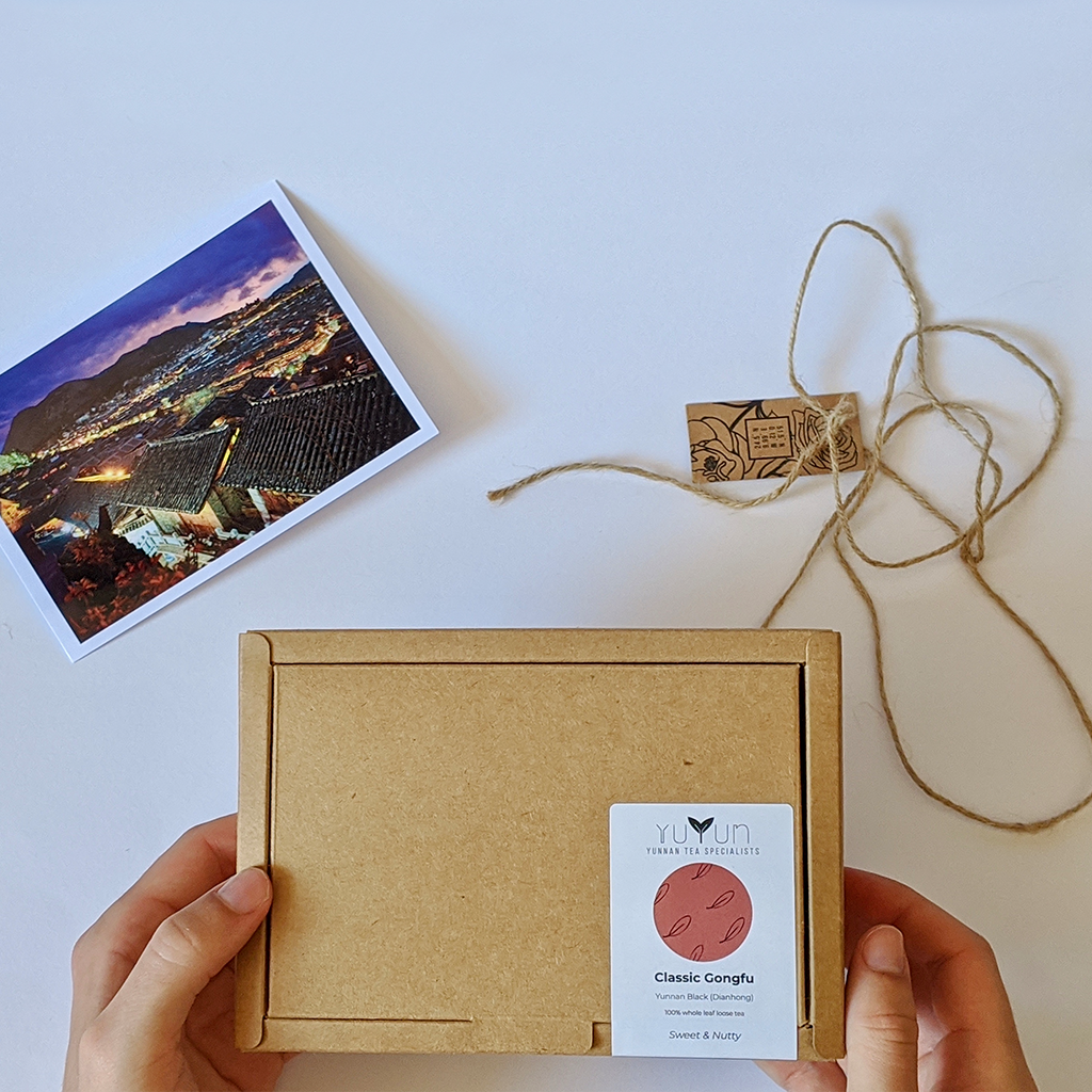 Photo of Yuyun's packaging with a postcard