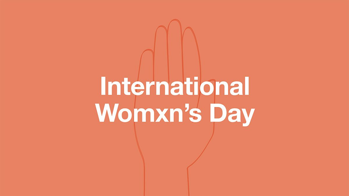 A peach-coloured banner which reads: 'International womxn's day'.