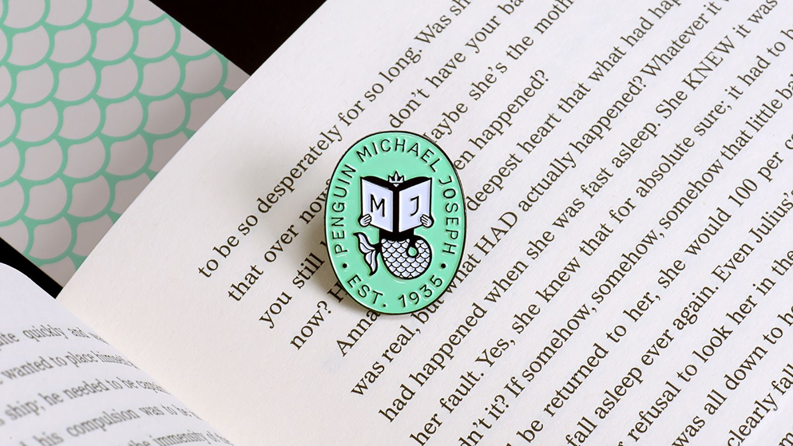 A badge sitting on a printed book.