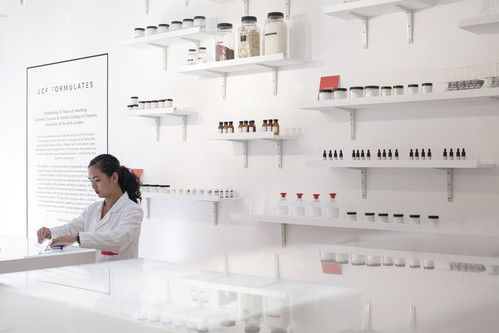 Image of cosmetic scientist testing in a lab.