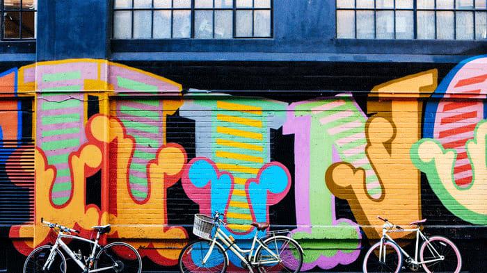 Bikes against a graffiti wall near London College of Fashion