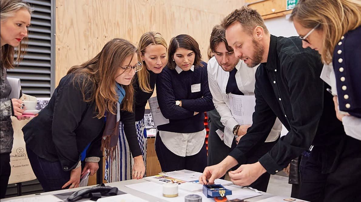 Louis Vuitton staff and academics reviewing student work