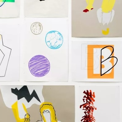 Photo of colourful pieces of art hanging on a white background
