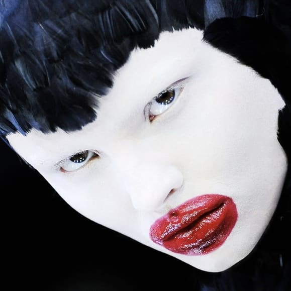 Model with white face red lips