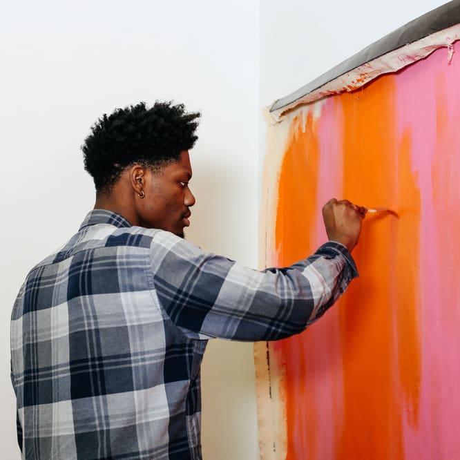 Kourtney Stuart-Mason painting in the studio