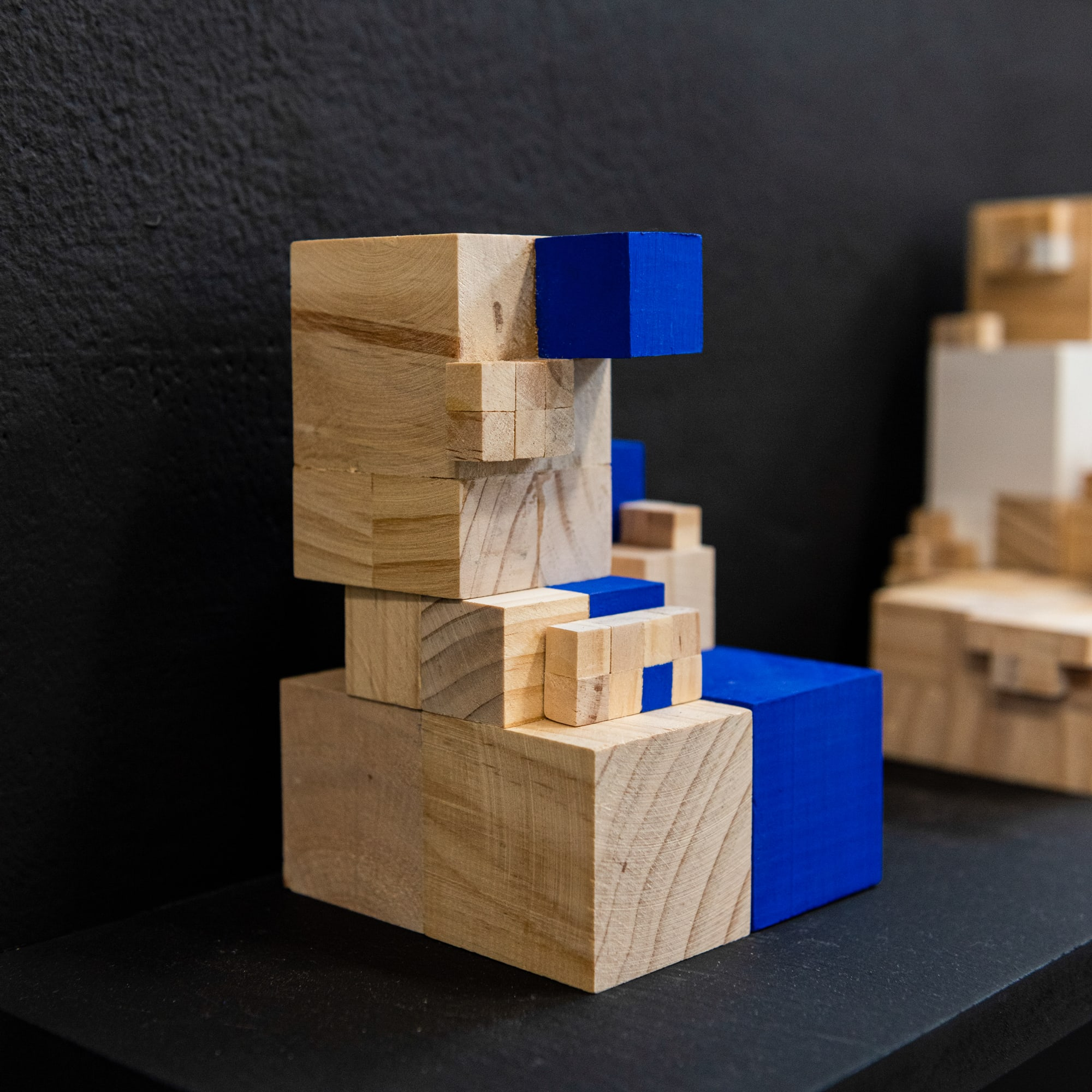 Construction of wooden blocks on a shelf