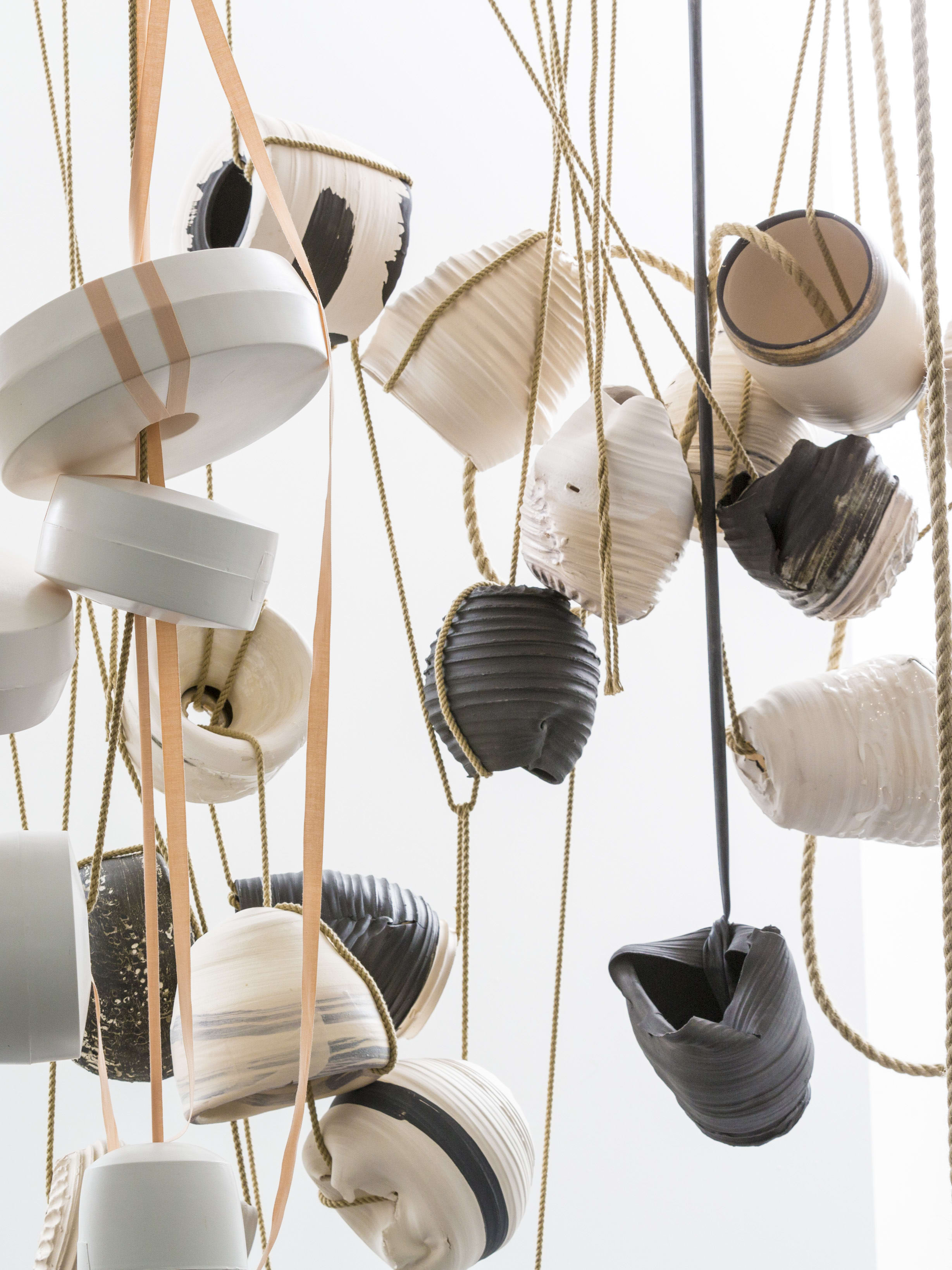 Ceramic objects hanging from string