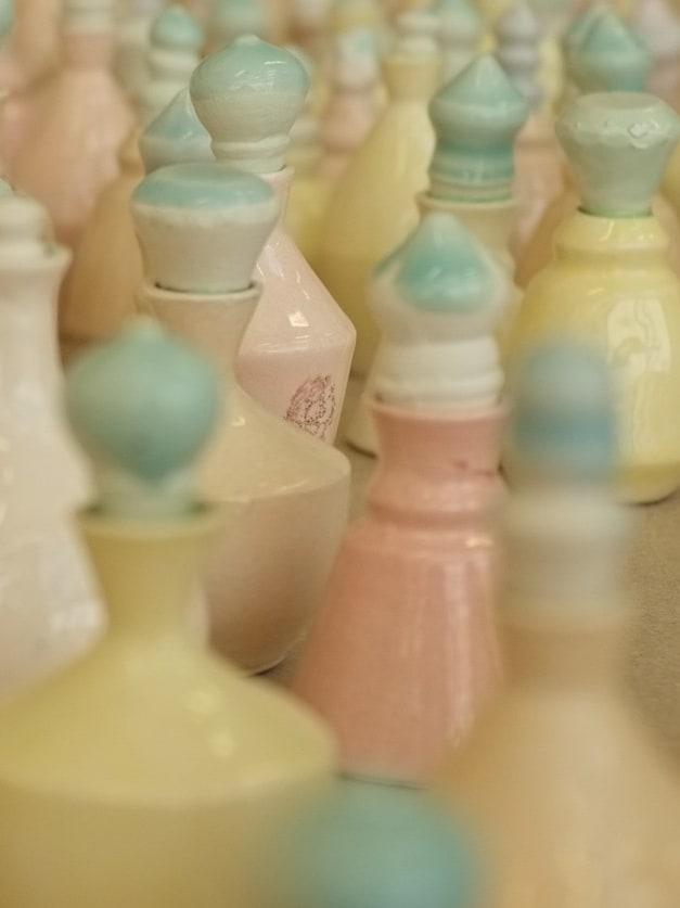 Small multicoloured ceramic pieces arranged on a floor
