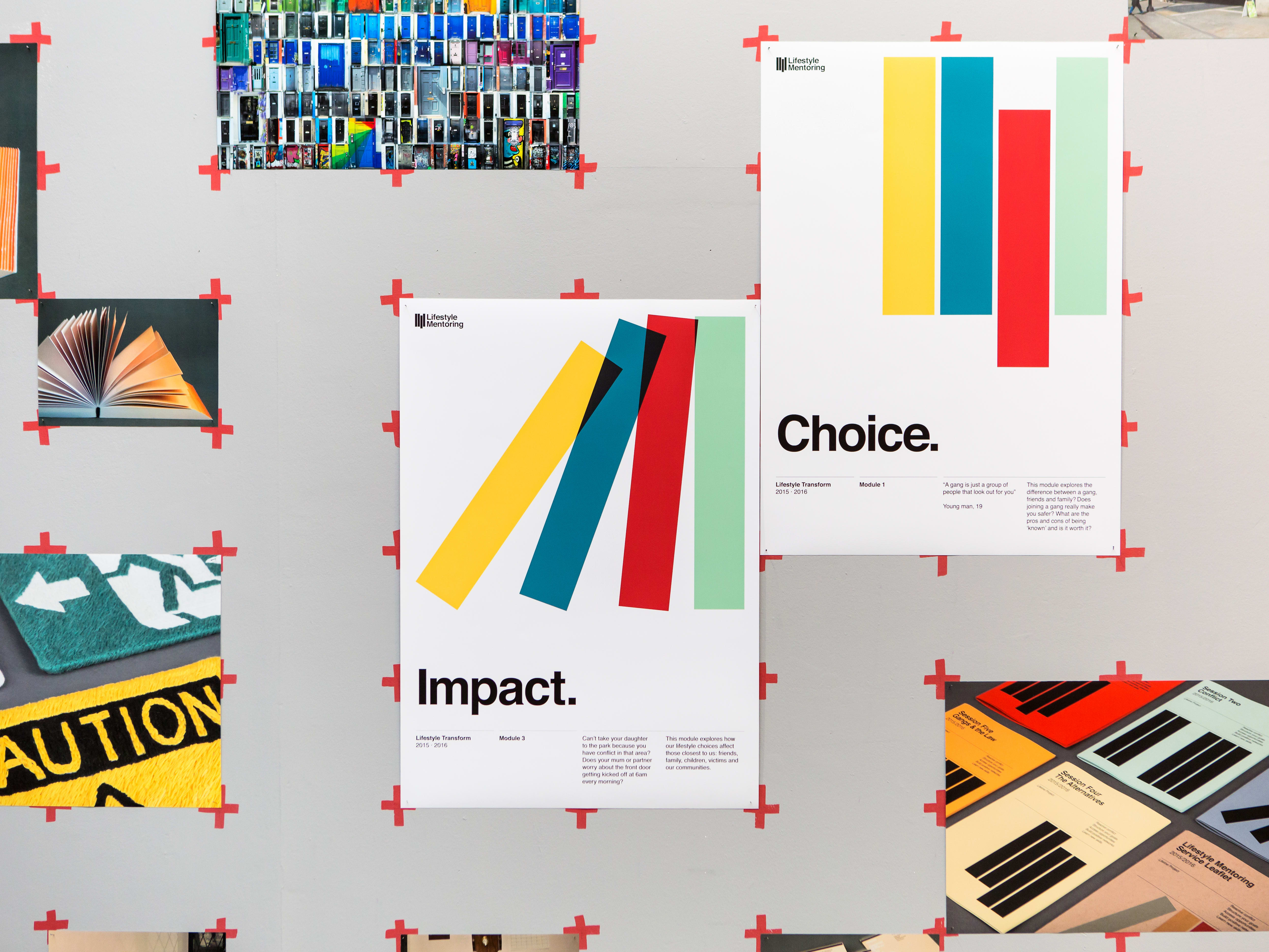 Colourful posters on a wall reading