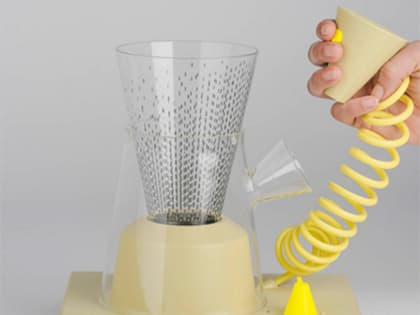 Yellow object that resembles a food processor, with bright yellow cord.