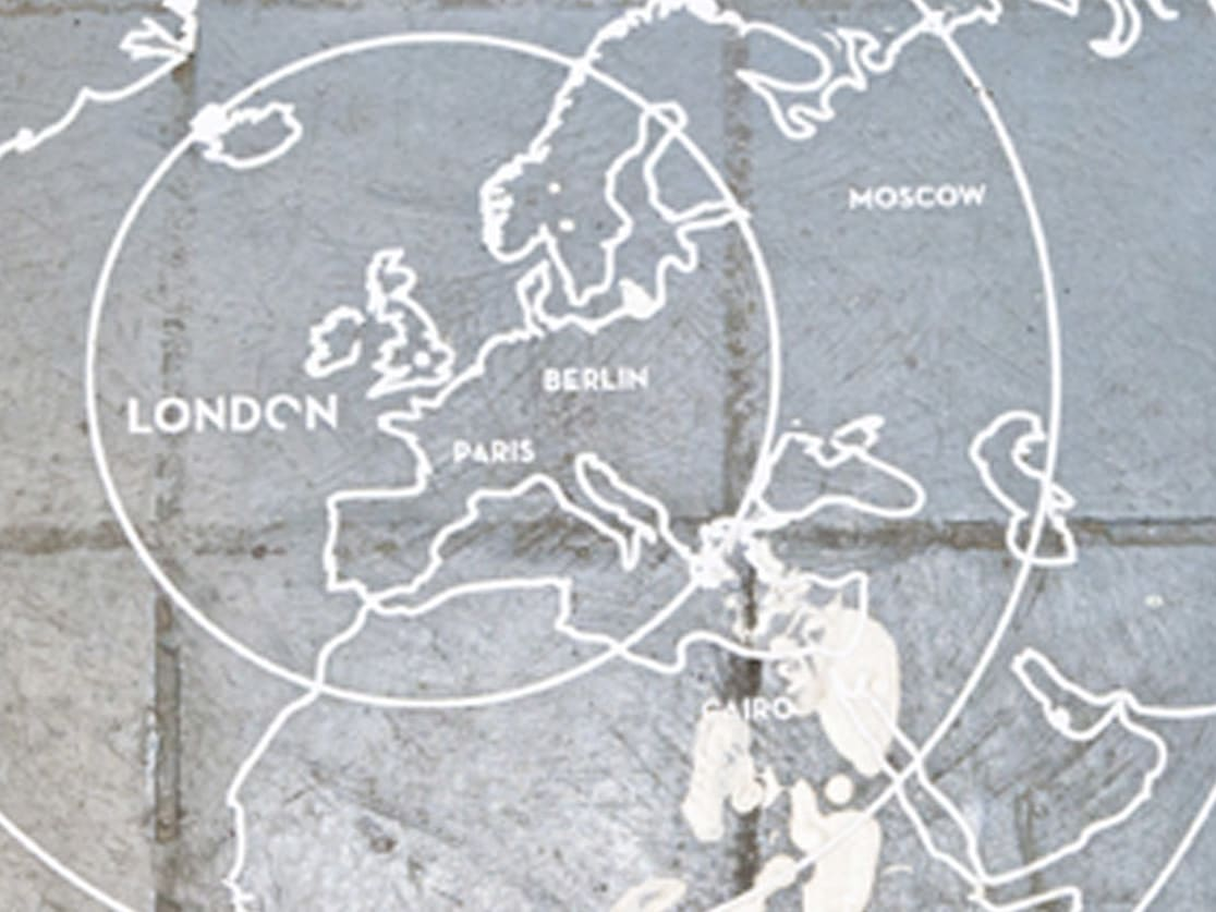 A map of Europe and other continents drawn on a cobbled floor