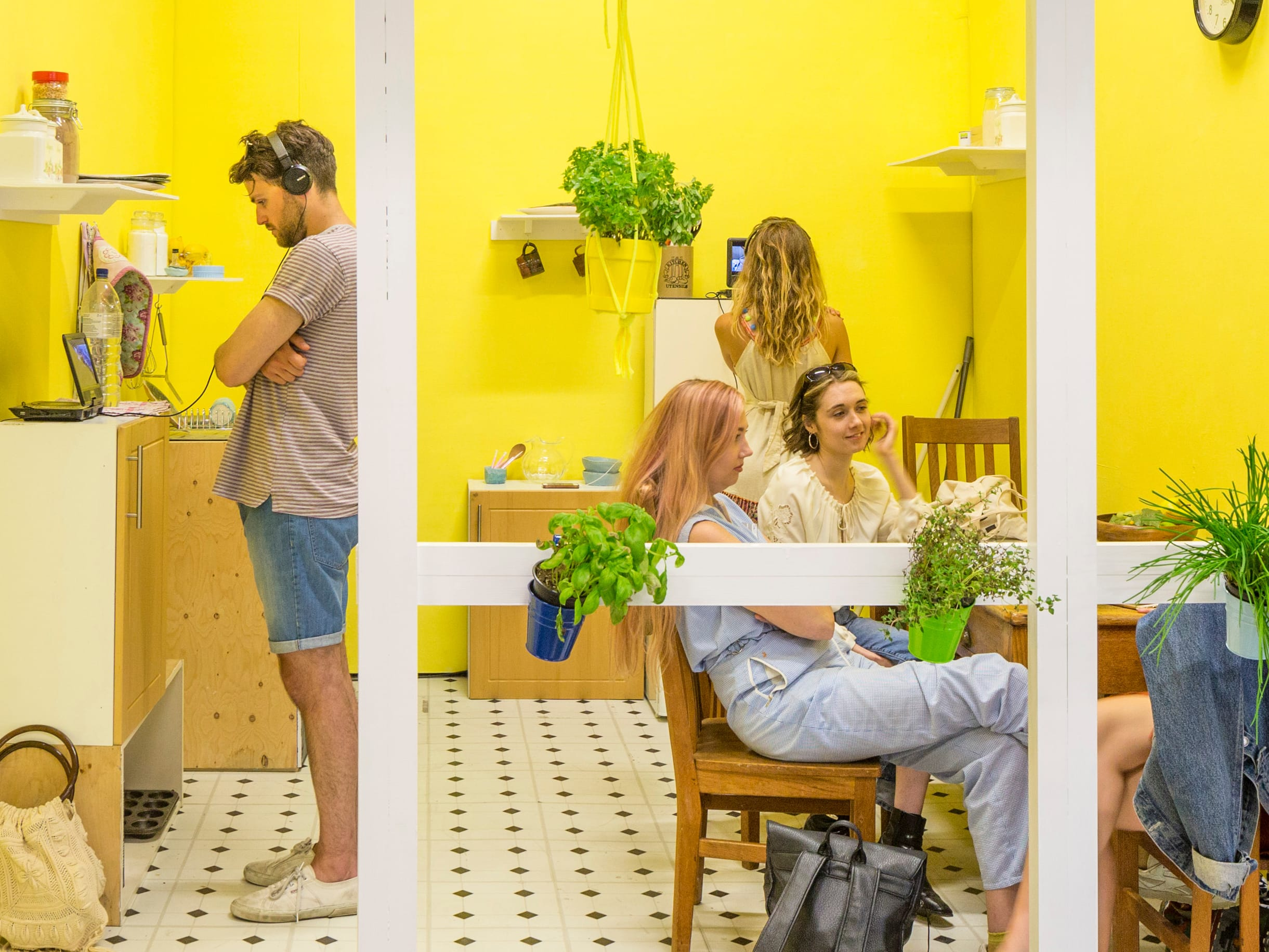 People inside an installation with bright yellow walls