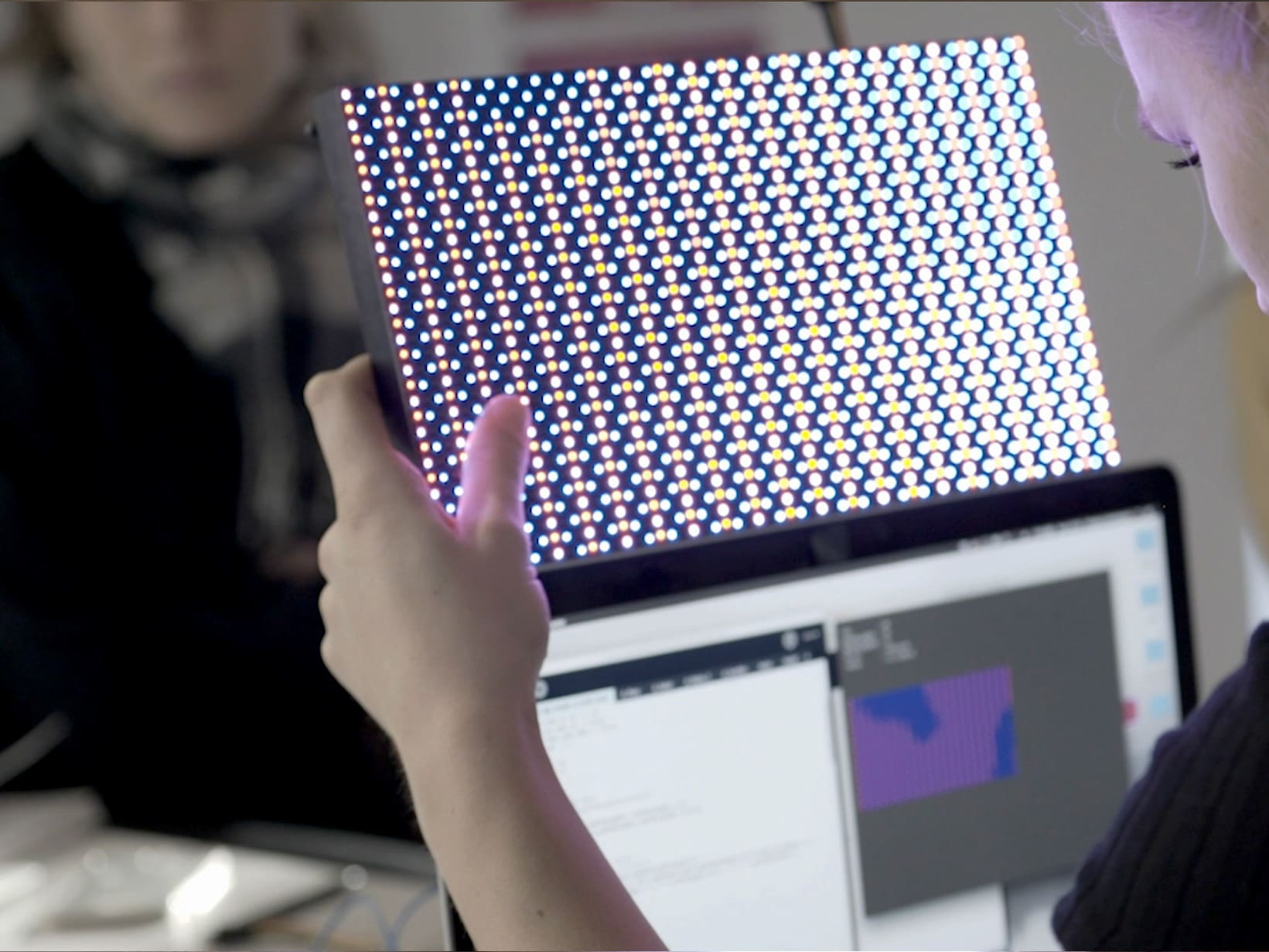 Student holding up a digital tool