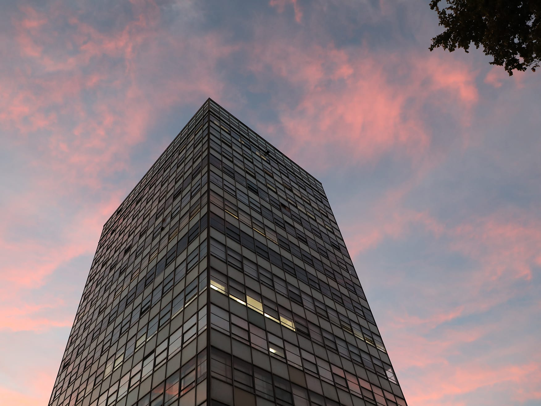 Photograph of LCC's tower block against a pink sky.