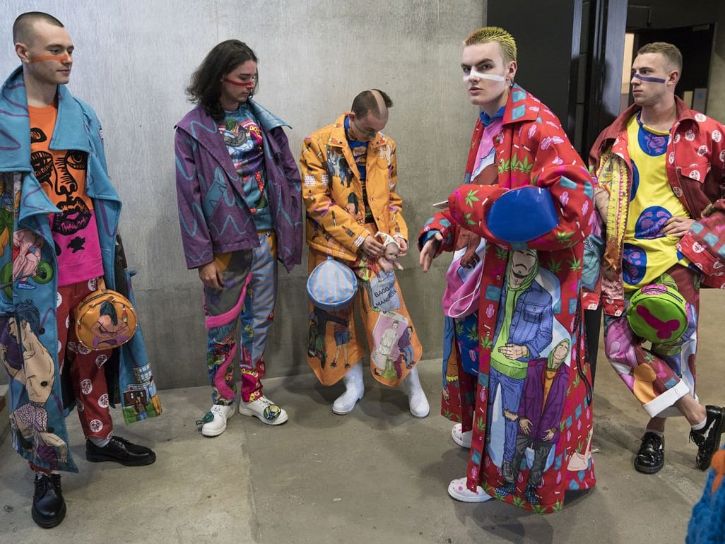 Models wearing brightly coloured clothes
