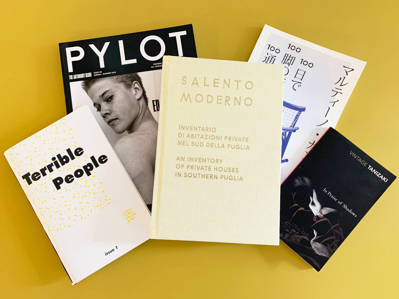 A selection of MA Publishing publications laid against a yellow background.