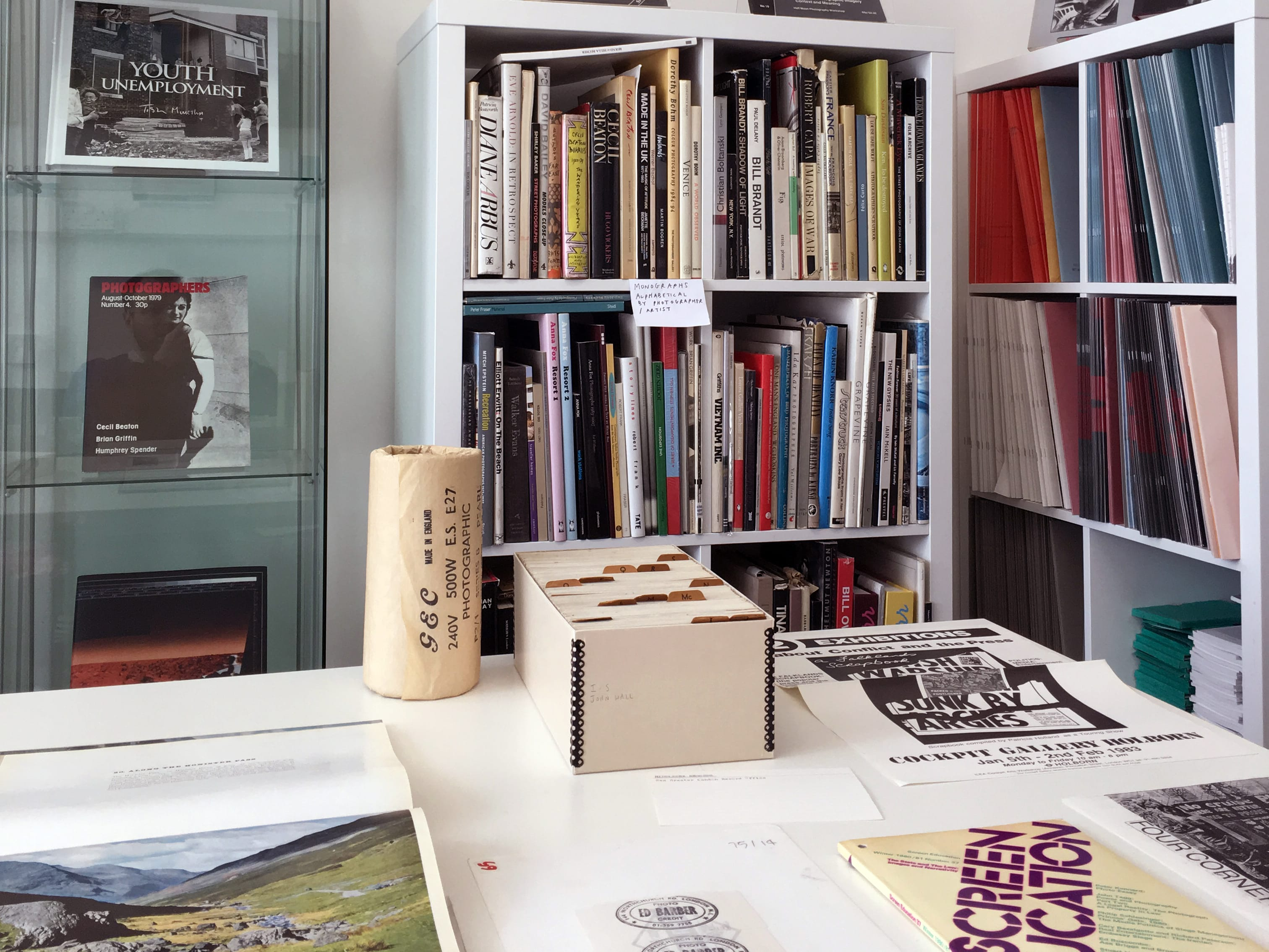 Photograph of Parc research space at London College of Communication, with bookcases and a table display showing photography books.