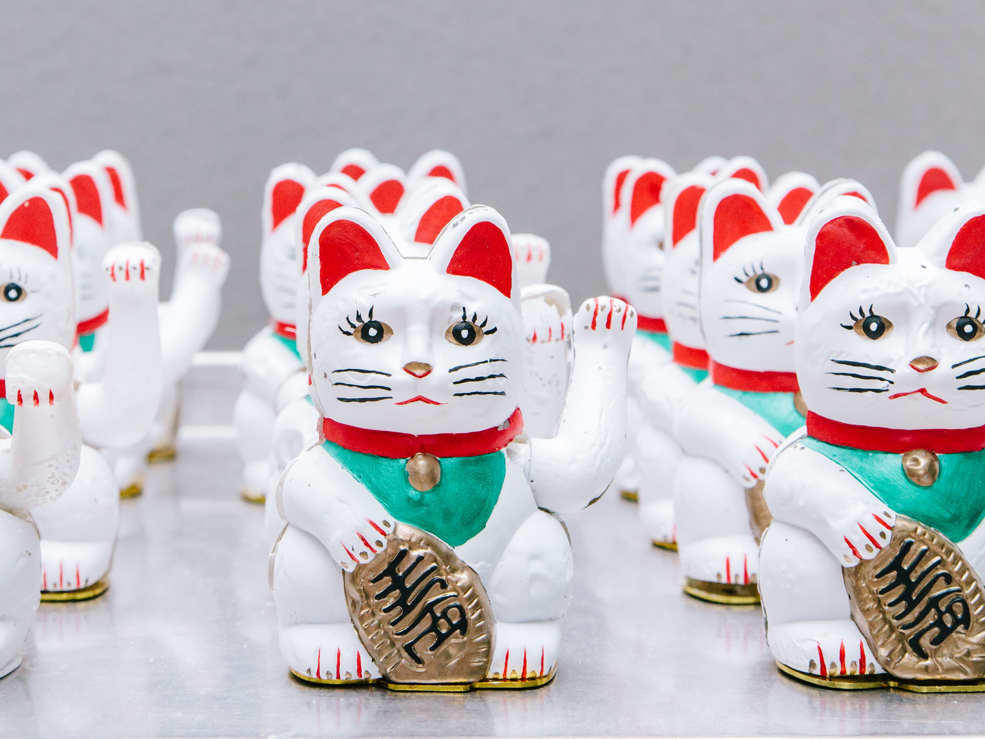 Cat ornaments in a row